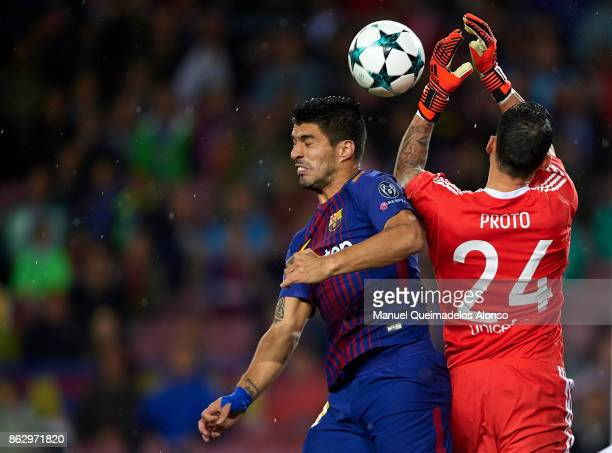 Luis Suarez of Barcelona competes for the ball with Silvio Proto of Olympiakos during the UEFA Champions League group D match between FC Barcelona...