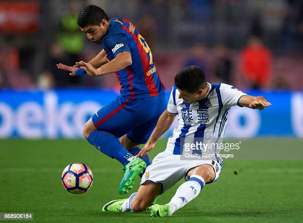 Luis Suarez of Barcelona competes for the ball with Yuri Berchiche Izeta of Real Sociedad during the La Liga match between FC Barcelona and Real...