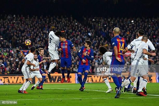 Luis Suarez of Barcelona head the ball to score the opening goal during the La Liga match between FC Barcelona and Real Madrid CF at Camp Nou on...