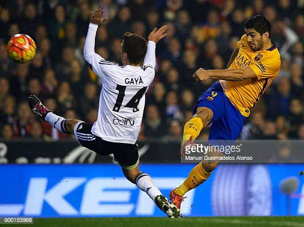 Luis Suarez of Barcelona in action next to Jose Gaya of Valencia during the La Liga match between Valencia CF and FC Barcelona at Estadi de Mestalla...