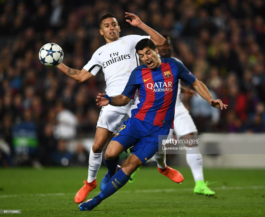 Luis Suarez of Barcelona is challenged by Marquinhos of PSG to earn a penalty during the UEFA Champions League Round of 16 second leg match between FC Barcelona and Paris Saint-Germain at Camp Nou on March 8, 2017 in Barcelona, Spain.