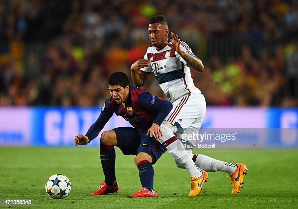 Luis Suarez of Barcelona is closed down byJerome Boateng of Bayern Muenchen during the UEFA Champions League Semi Final first leg match between FC...