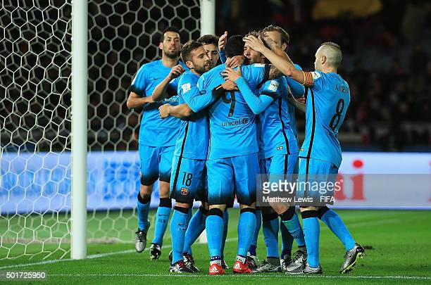 Luis Suarez of Barcelona is congratulated on scoring his third goal during the FIFA Club World Cup Semi Final match between Barcelona and Guangzhou...