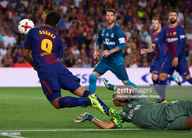 Luis Suarez of Barcelona is tackled by Keylor Navas of Real Madrid during the Supercopa de Espana Supercopa Final 1st Leg match between FC Barcelona...
