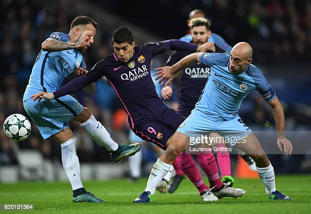 Luis Suarez of Barcelona is tackled by Nicolas Otamendi of Manchester City and Pablo Zabaleta of Manchester City during the UEFA Champions League...