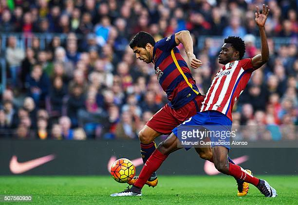 Luis Suarez of Barcelona is tackled by Thomas of Atletico de Madrid during the La Liga match between FC Barcelona and Atletico de Madrid at Camp Nou...