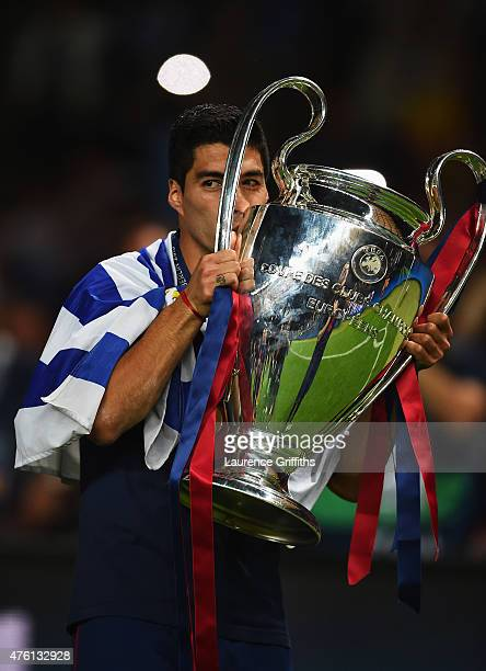 Luis Suarez of Barcelona kisses the trophy as he celebrates victory after the UEFA Champions League Final between Juventus and FC Barcelona at...