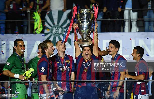 Luis Suarez of Barcelona lifts the trophy as he celebrates victory with team mates after the UEFA Champions League Final between Juventus and FC...