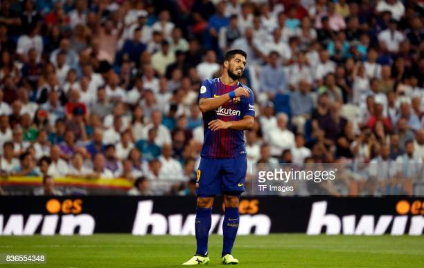 Luis Suarez of Barcelona looks on during the Supercopa de Espana Supercopa Final 2nd Leg match between Real Madrid and FC Barcelona at Estadio...