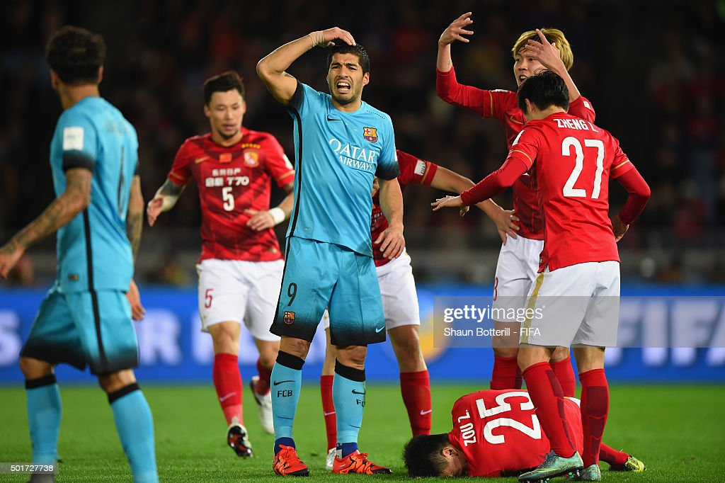 Luis Suarez of Barcelona looks shocked after the injury to Zou Zheng of Guangzhou Evergrande FC during the FIFA Club World Cup Semi Final match...