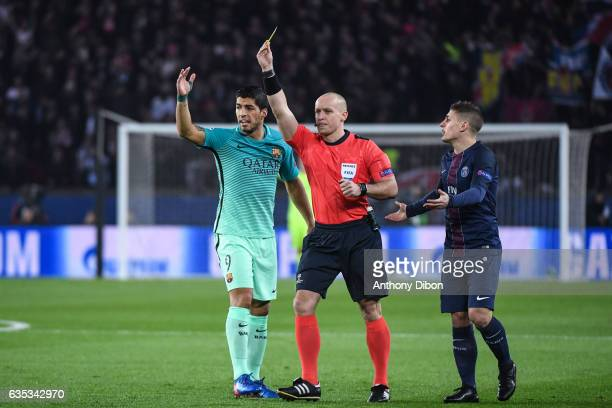 Luis Suarez of Barcelona referee Szymon Marciniak and Marco verratti of PSG during the Champions league match between Paris Saint Germain and FC...