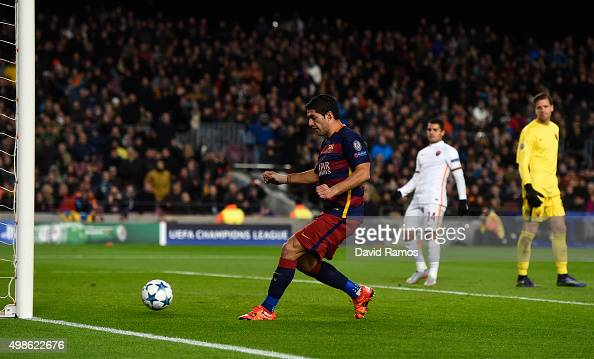 Luis Suarez of Barcelona scores his teams opening goal during the UEFA Champions League Group E match between FC Barcelona and AS Roma at Camp Nou on...