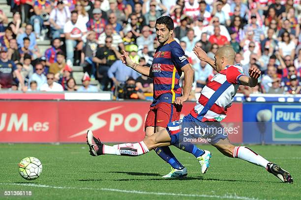 Luis Suarez of Barcelona scores his team's third and hat trick goal during the La Liga match between Granada and Barcelona at Estadio Nuevo Los...