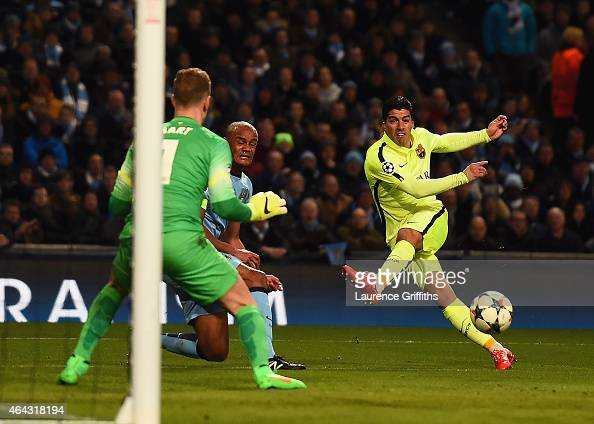 Luis Suarez of Barcelona scores the opening goal past Joe Hart of Manchester City during the UEFA Champions League Round of 16 match between...