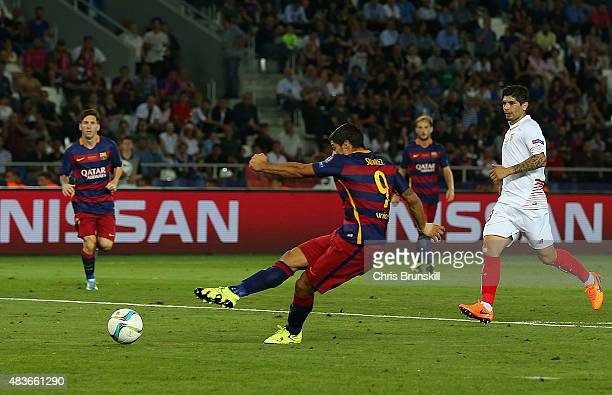 Luis Suarez of Barcelona scores their fourth goal during the UEFA Super Cup between Barcelona and Sevilla FC at Dinamo Arena on August 11 2015 in...