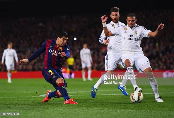 Luis Suarez of Barcelona shoots past Sergio Ramos and Pepe of Real Madrid CF to score their second goal during the La Liga match between FC Barcelona...