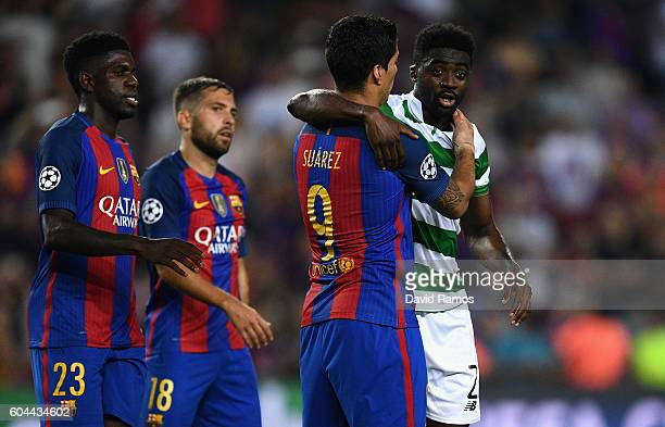Luis Suarez of Barcelona speaks with Kolo Toure of Celtic during the UEFA Champions League Group C match between FC Barcelona and Celtic FC at Camp...