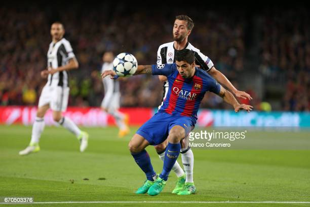STADIUM BARCELONA SPAIN Luis Suarez of Fc Barcelona and Miralem Pjanic of Juventus Fc battle for the ball during the UEFA Champions League quarter...