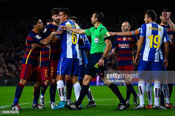 Luis Suarez of FC Barcelona argues with RCD Espanyol players during the Copa del Rey Round of 16 first leg match between FC Barcelona and RCD...