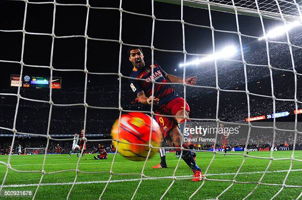 Luis Suarez of FC Barcelona celebrates after Heiko Westermann of Real Betis Balompie scored an own goal during the La Liga match between FC Barcelona...