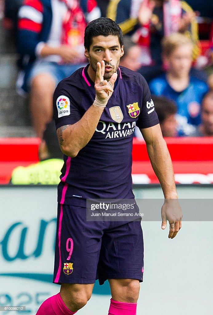 Luis Suarez of FC Barcelona celebrates after scoring goal during the La Liga match between Real Sporting de Gijon and FC Barcelona at Estadio El Molinon on September 24, 2016 in Gijon, Spain.