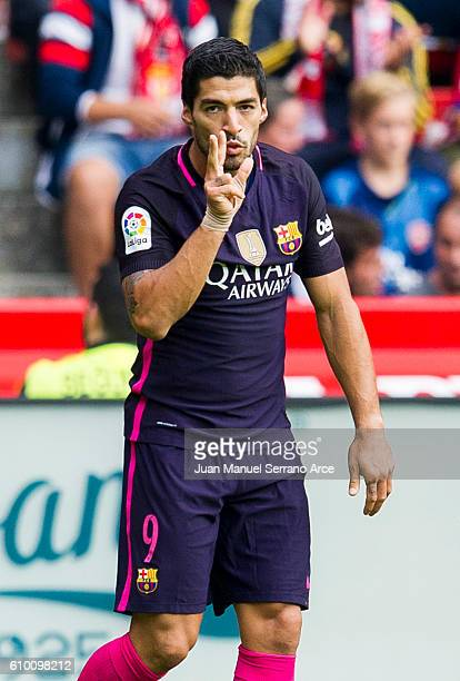 Luis Suarez of FC Barcelona celebrates after scoring goal during the La Liga match between Real Sporting de Gijon and FC Barcelona at Estadio El...