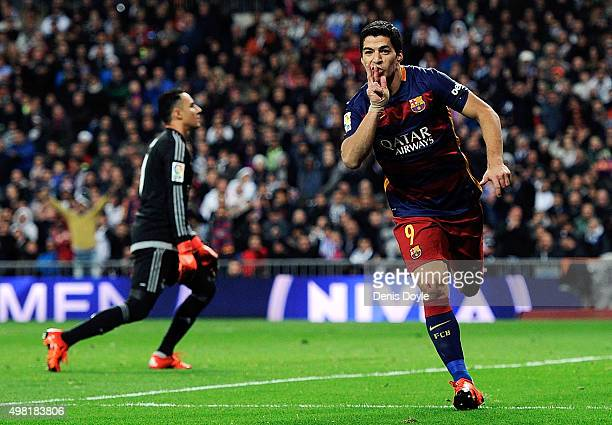 Luis Suarez of FC Barcelona celebrates after scoring his team's 4th goal during the La Liga match between Real Madrid and Barcelona at Estadio...