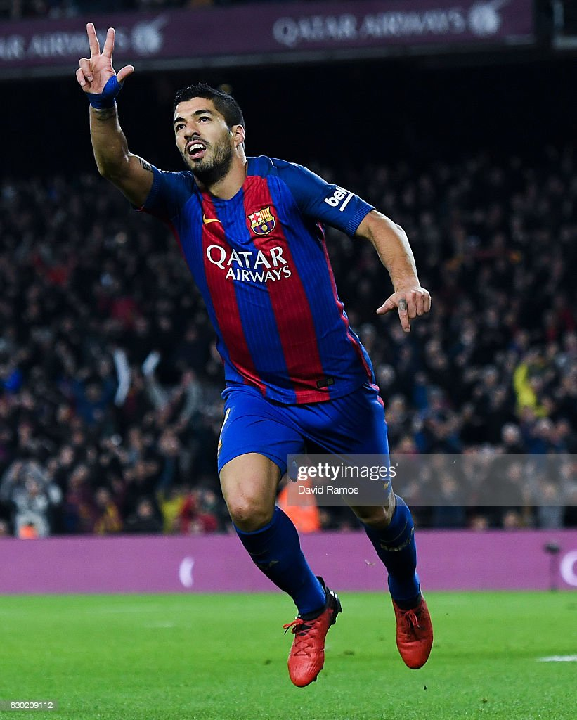 Luis Suarez of FC Barcelona celebrates after scoring his team's first goal during the La Liga match between FC Barcelona and RCD Espanyol at the Camp Nou stadium on December 18, 2016 in Barcelona, Spain.