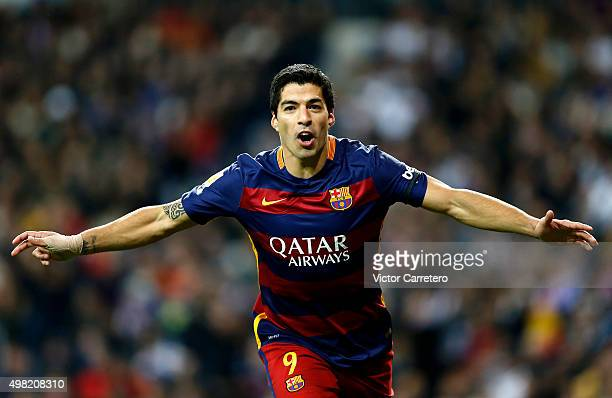Luis Suarez of FC Barcelona celebrates after scoring his team's fourth goal during the La Liga match between Real Madrid CF and FC Barcelona at...