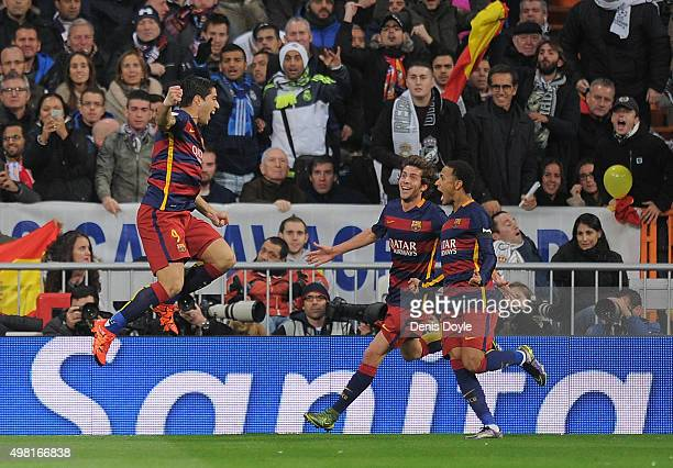 Luis Suarez of FC Barcelona celebrates after scoring his team's opening goal during the La Liga match between Real Madrid and Barcelona at Estadio...