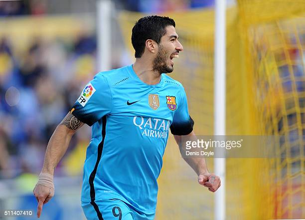 Luis Suarez of FC Barcelona celebrates after scoring his team's opening goal during the La Liga match between UD Las Palmas and FC Barcelona at...