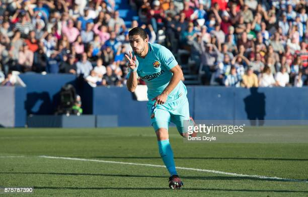 Luis Suarez of FC Barcelona celebrates after scoring his team's opening goal during the La Liga match between Leganes and Barcelona at Estadio...