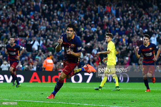 Luis Suarez of FC Barcelona celebrates after scoring his team's second goal from the penalty spot during the La Liga match between FC Barcelona and...