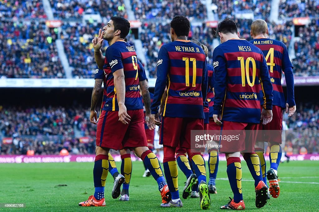 Luis Suarez (L) of FC Barcelona celebrates after scoring his team's second goal during the La Liga match between FC Barcelona and Real Sociedad de Futbol at Camp Nou on November 28, 2015 in Barcelona, Spain.