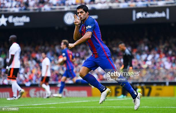Luis Suarez of FC Barcelona celebrates after scoring his team's second goal during the La Liga match between Valencia CF and FC Barcelona at Mestalla...