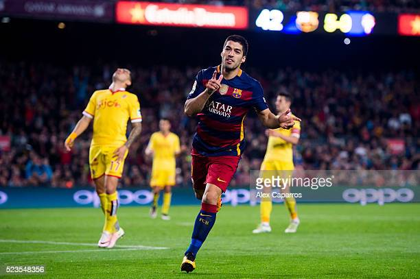 Luis Suarez of FC Barcelona celebrates after scoring his team's sixth goal during the La Liga match between FC Barcelona and Sporting Gijon at Camp...