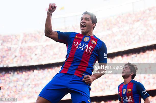 Luis Suarez of FC Barcelona celebrates after scoring his team's third goal during the La Liga match between FC Barcelona and Real Betis Balompie at...
