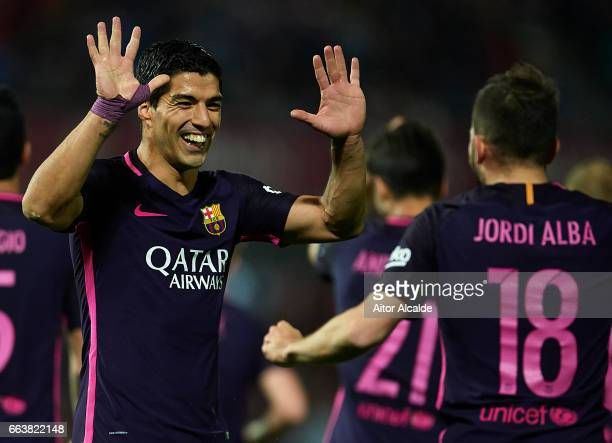 Luis Suarez of FC Barcelona celebrates after scoring the first goal for FC Barcelona with his team mate Jordi Alba of FC Barcelona during the La Liga...