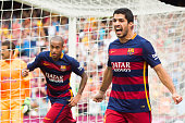 Luis Suarez of FC Barcelona celebrates after scoring the opening goal during the La Liga match between FC Barcelona and UD Las Palmas at Camp Nou on...