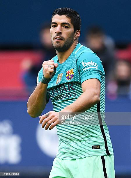 Luis Suarez of FC Barcelona celebrates after scoring the opening goal during the La Liga match between CA Osasuna and FC Barcelona at Sadar stadium...