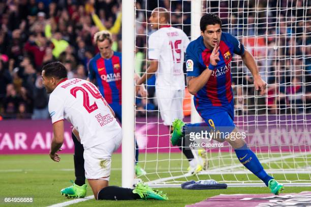 Luis Suarez of FC Barcelona celebrates after scoring the opening goal during the La Liga match between FC Barcelona and Sevilla FC at Camp Nou...