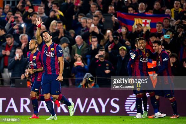Luis Suarez of FC Barcelona celebrates close to his teammates Dani Alves Neymar Santos Jr and Lionel Messi after scoring his team's second goal...