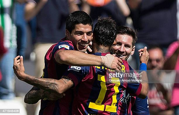 Luis Suarez of FC Barcelona celebrates scoring their fourth goal with teammates Neymar JR and Lionel Messi during the La Liga match between Cordoba...