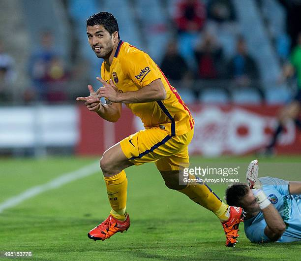 Luis Suarez of FC Barcelona celebrates scoring their opening goal during the La Liga match between Getafe CF and FC Barcelona at Coliseum Alfonso...