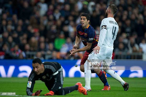 Luis Suarez of FC Barcelona celebrates scoring their opening goal during the La Liga match between Real Madrid CF and FC Barcelona at Estadio...