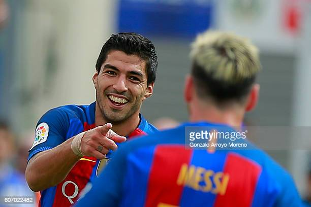Luis Suarez of FC Barcelona celebrates scoring their second goal with teammate Lionel Messi during the La Liga match between Deportivo Leganes and FC...