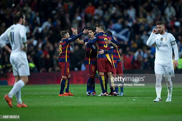 Luis Suarez of FC Barcelona celebrates their victory with his teammates as Gareth Bale and Sergio Ramos of Real Madrid CF react defeated after the La...