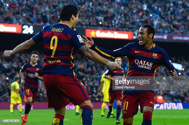 Luis Suarez of FC Barcelona celebrates with his team mate Neymar of FC Barcelona after scoring his team's second goal from the penalty spot during...