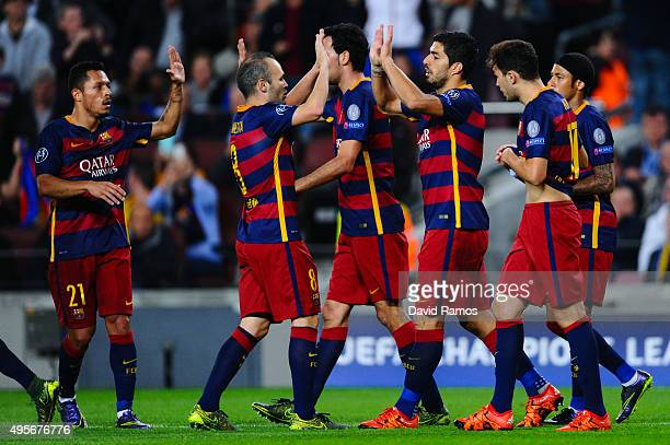 Luis Suarez of FC Barcelona celebrates with his team mates after scoring his team's second goal during the UEFA Champions League Group E match...