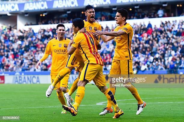 Luis Suarez of FC Barcelona celebrates with his team mates after scoring the opening goalduring the La Liga match between RC Deportivo La Coruna and...